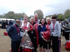 Andrea Earley, Elizabeth Aspden-Mansfield, Jacqui Campbell, Paul Clayton, Odette Foxall, Diane Wildbur and Helen Wilebore after London marathon