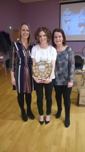 Celine Guery (Centre) with her Female Runner of the Year Shield