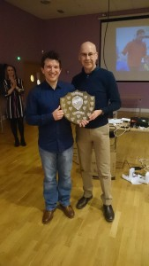 Paul Clayton (R) receiving Male Runner of the Year from Ed Nixon.